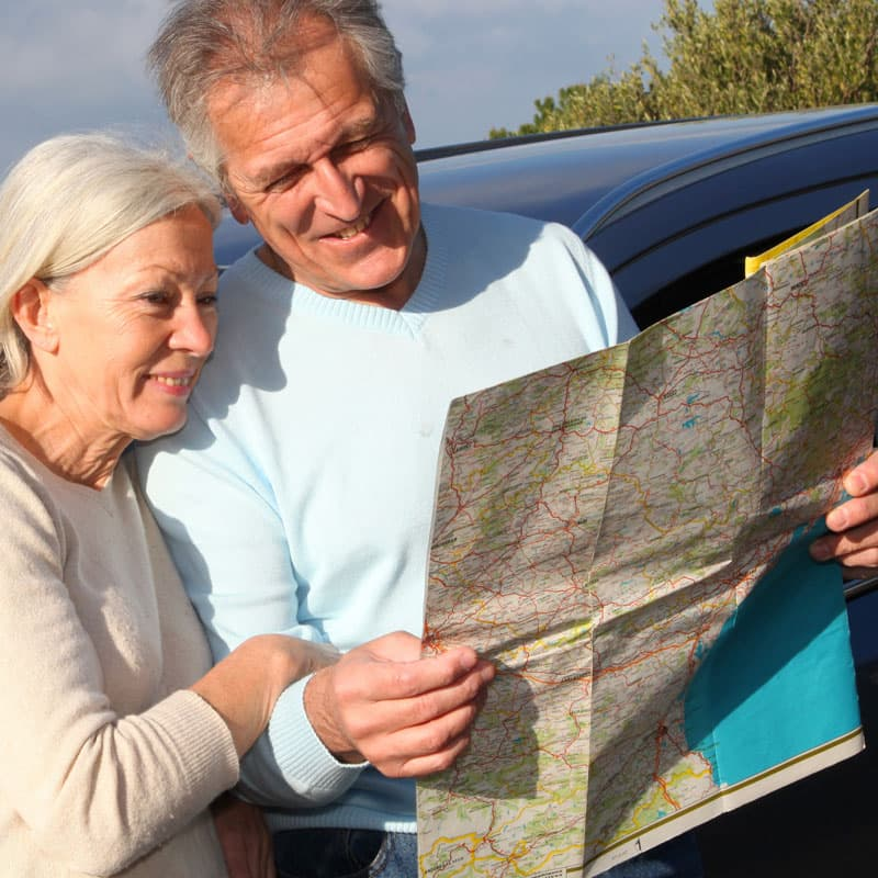Retired Couple Looking at Roadmap - Retirement Planning Dandenong
